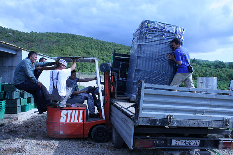 Unloading the wine bottles at Krolo Winery